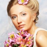 Woman with pink flowers Stock Photo