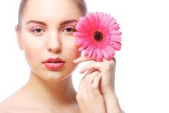 Woman with pink gerber flower Stock Photography