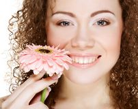 Woman with pink gerber Royalty Free Stock Images