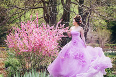 Woman in pink gown Stock Photography