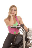 Woman pink green sit motorcycle close Royalty Free Stock Photos