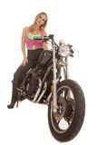 Woman pink green sit serious motorcycle Royalty Free Stock Images