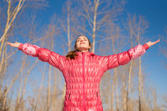 Woman in pink greeting the sun Royalty Free Stock Photos