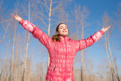 Woman in pink greeting the sun Royalty Free Stock Image
