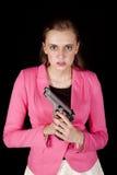 Woman pink gun looking Stock Image