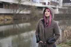 Woman with pink hair in bleak surroundings Stock Images