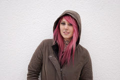 Woman with pink hair piercings and tattoos stock photos