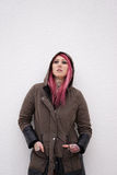 Woman with pink hair piercings and tattoos royalty free stock images