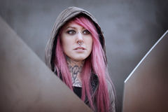 Woman with pink hair piercings and tattoos royalty free stock image