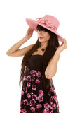 Woman in pink hat and dress with flowers smile Stock Photography