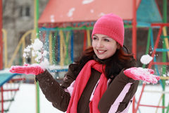 Woman in pink hat play with snow in winter Stock Photo