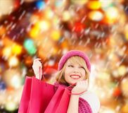 Woman in pink hat and scarf with shopping bags Stock Photos