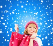 Woman in pink hat and scarf with shopping bags Royalty Free Stock Image