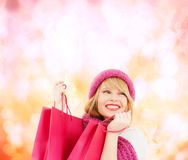 Woman in pink hat and scarf with shopping bags. Winter, people and happiness concept - woman in pink hat and scarf with many shopping bags Royalty Free Stock Photos