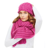 Woman in pink hat and scarf. Winter, people and happiness concept - woman in pink hat and scarf Royalty Free Stock Photo