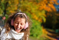 Woman with pink headpieces. Young fresh smiling woman with pink headpieces in autumn Royalty Free Stock Photography
