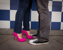 Woman with Pink Heels and Man in Black Chucks Royalty Free Stock Photography