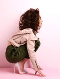 Woman in pink high heels shoes wearing leather designers jacket Royalty Free Stock Photo