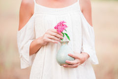 Woman with pink hydrangea Stock Photography