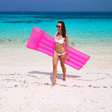 Woman with pink inflatable raft at the beach Royalty Free Stock Images