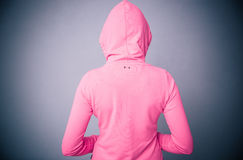 Woman in pink jacket with hood Stock Photos