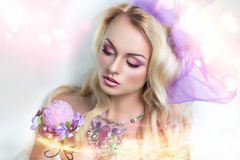 Woman with pink jewelry. Portrait of beautiful young sexy lady, model, woman, actress, princess. Perfect makeup, long eyelashes, clean soft skin, gentle pink Stock Photos