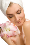 Woman with pink lily Stock Photography