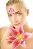 Woman with pink lily Royalty Free Stock Images