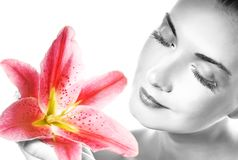 Woman with pink lily Royalty Free Stock Photography