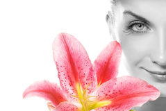 Woman with pink lily Stock Photos