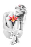 Woman with pink lily flower Stock Image