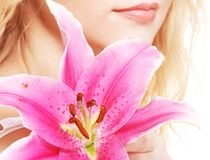 Woman with pink lily high-key portrait Stock Images