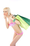 Woman in pink lingerie holding shopping bags Royalty Free Stock Photos