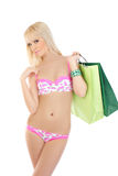 Woman in pink lingerie holding shopping bags Stock Photos