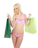 Woman in pink lingerie with shopping bags Royalty Free Stock Images
