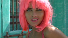 Woman in pink lingerie and wig stock video footage