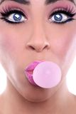 Woman With Pink Make Up Blowing Pink Bubblegum Bubble Stock Image