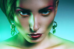 Woman with pink make up in green light. In studio Royalty Free Stock Photography