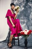 Woman in Pink Maxi Dress Holding Bouquet of Flowers Royalty Free Stock Photos