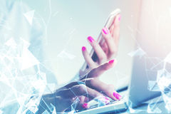 Woman with pink nails holding smartphone double Royalty Free Stock Photography