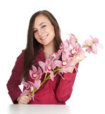 Woman with pink orchid Stock Images