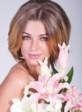 woman with pink orchid Stock Photo