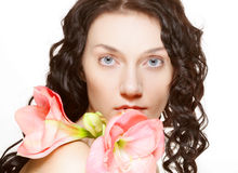 Woman and pink orchid Royalty Free Stock Photography