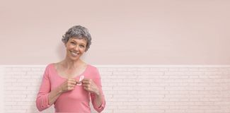 Composite image of woman in pink outfits showing ribbon for breast cancer awareness royalty free stock photo