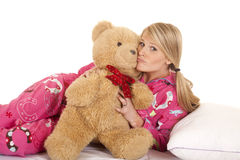 Woman pink pajamas bear kiss look Royalty Free Stock Photography