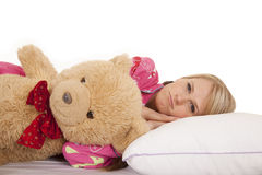 Woman pink pajamas bear lay Stock Photos