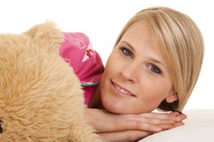 Woman pink pajamas bear lay look Stock Photo