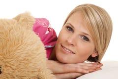 Woman pink pajamas bear lay look Stock Photo