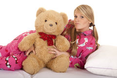 Woman pink pajamas bear lay on side look Royalty Free Stock Photo
