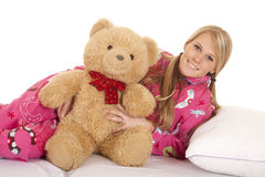 Woman pink pajamas bear lay on side smile Stock Image